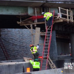 Installing demolition shield on Bridge 1017 Pier cap.
