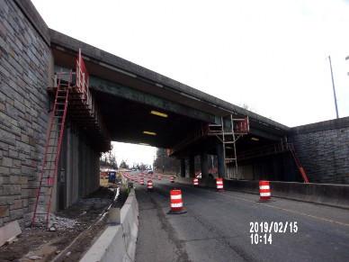 Demolishing top portion of Bridge 1016 Abutment A stem wall