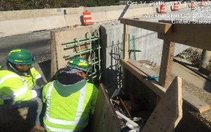 Installing rebars and forms for modified safety shape barrier bridge 1017, southeast corner