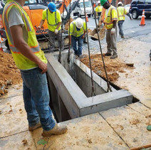Installing the double catch basin between P and Q Streets