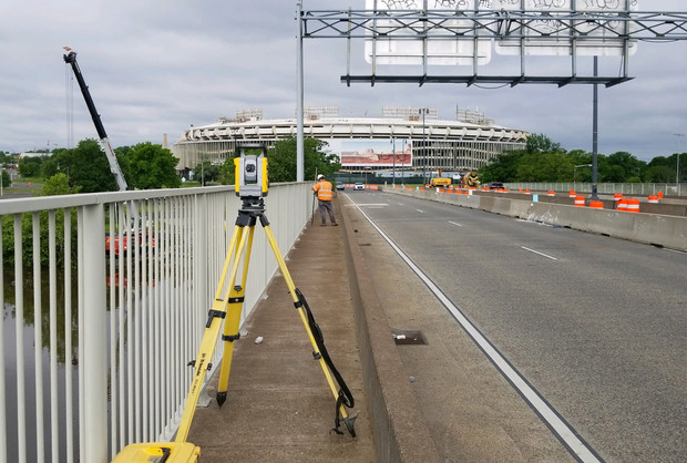 Contractor Surveying to Layout Along East Capitol Street Bridge Looking West