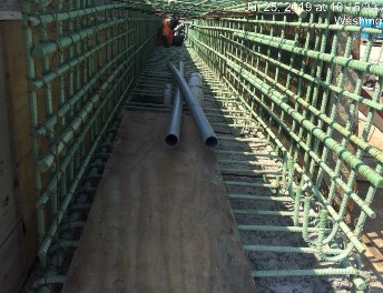 Placing concrete in stemwall and beam seats reconstruction Phase B, Bridge 1016 abutment A