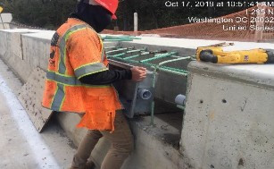 Installing electrical junction box on bridge 1016 northeast moment slab parapet