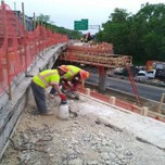 """Saw-cutting for proposed 3"""" Dia. Perforated SDR 35 pipe on AFW Bridge # 1017(I-295SB) over South Capitol St. SEB."""