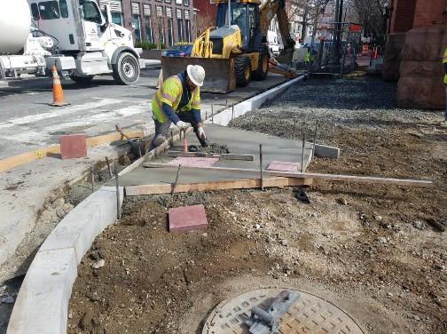 ADA Ramp installed at the SE corner of Corcoran Street