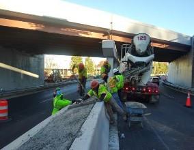 Placing concrete cap on PC half curb median barrier