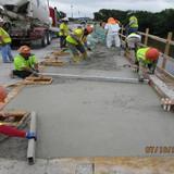 Placing Sidewalk Concrete, South Bridge.