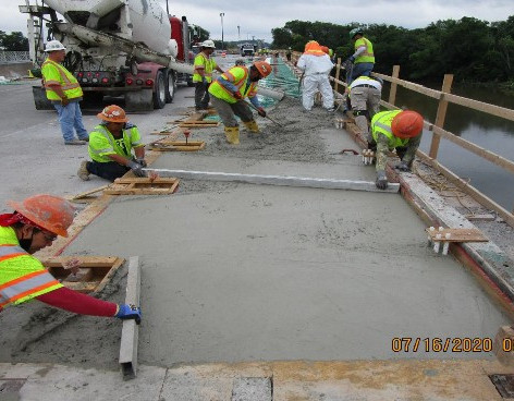Placing Sidewalk Concrete, South Bridge.