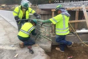 Installing rebars for modified safety shape barrier SE corner Bridge 1017