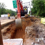Excavating to install pipe from ex I-3 to proposed QI-4