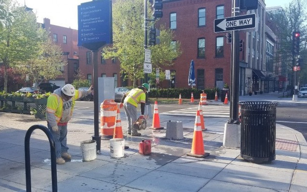 FMCC working on removing the T-base at NEC of Q Street