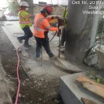 """Drilling holes 18"""" deep for PCC barrier rebars"""