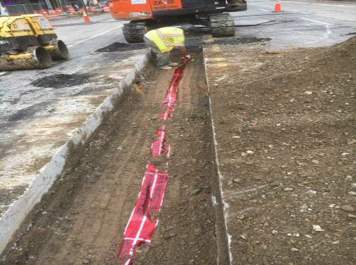 Backfill of Encased Electrical Trench and placement of Electrical Tape