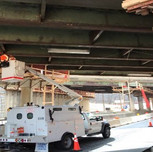 Jaxon Point installing temporary iunderbridge lighting.