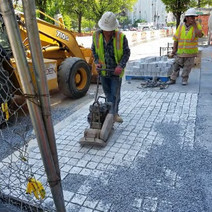 Placing Granite Cobble Stone between Thomas Circle and N Street Westside
