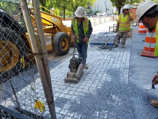 Placing Granite Cobble Stone between Thomas Circle and N Street Westside
