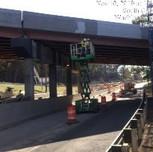 Applying primer on bridge 1016 span 2, west parapet.