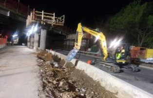 Demolition continues on median barrier base (Pier barrier base) on AFW Bridge # 1017 (I-295 SB) on South Capitol St. SW, right side of P.G.L approximately from Sta.103+40 to Sta.102+50.