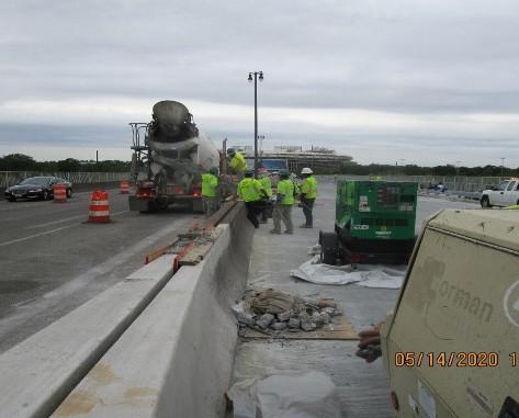 Repairing Median Barrier, South Bridge.