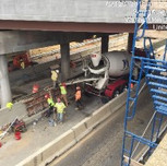Placing concrete in PCC half curb barrier