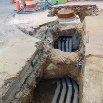 Installation of Manhole on the NW corner of Rhode Island Ave