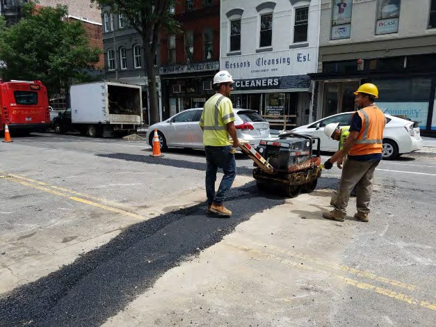 Placing Temporary Asphalt over the lateral trenches between N Street and Rhode Island Ave on the Westside