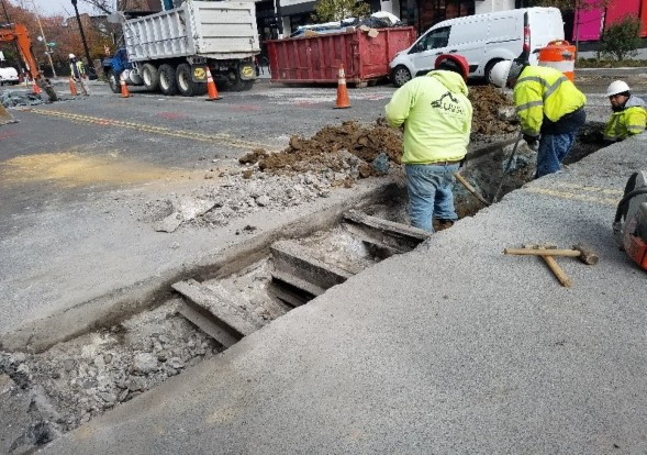 View of existing streetcar tracks at trench to be removed by Omni