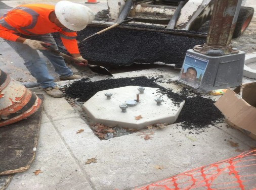 Placement of Temporary Asphalt around previously poured Street Light Foundation