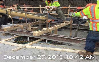 Placing Scupper Concrete, North Bridge.