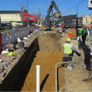 Excavation and sand placement at MLK from Parkland to Malcom X. Sta: 57+35 to Sta: 58+35