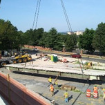 Crane placing removed deck on S. Capitol St. SEB