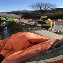 Placing Concrete for Median Barrier at East Approach.