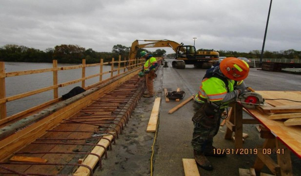 Installing Sidewalk Formwork at Pier 10, North Bridge.