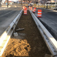 Placement of fill material for new median on MLK between Cypress & Lebaum