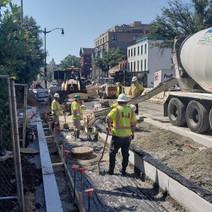 FMCC pouring concrete at bike lane near bus island near 14th & R