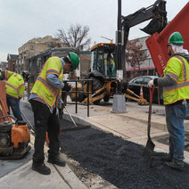FMCC spreading the 12.5 MM Surface mix by hand in the bike lane between Sta 26+53 & Sta 27+79 NB 14th Street NW