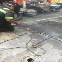 Contractor Welding Steel Plates