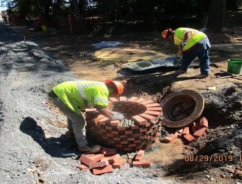 Adjusting Manhole # 31, Pedestrian Connection Path.