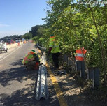 Removing W-beam guardrails on SB-295, north of bridge 1017, right of the baseline