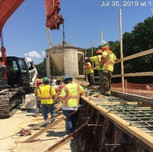 Placing concrete in bridge 1016 wingwall 1 on NB-295, right of the baseline