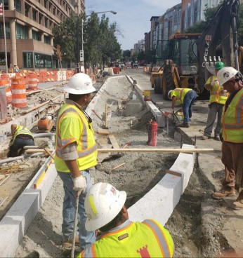 Bus Island granite curb installation at 14th St. NW & U St.