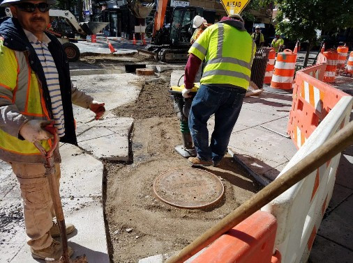 Compaction of material around manhole on Westside of Florida Ave and 14th Street