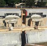 Cement grout around coupling on bridge 1017 west parapet