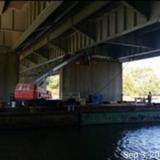 Installing Work Platform at Pier 13, North Bridge.