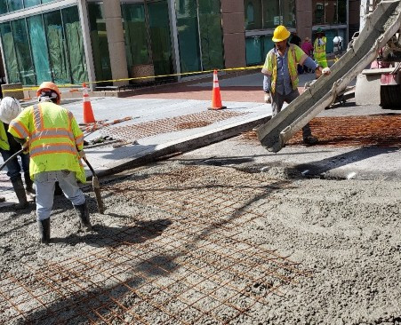 """DEN crew poured PCC 10"""" Class E with Roadway Dowels drilled into PCC Base & Wire Mesh at V St. NW & 14th St. Intersection."""