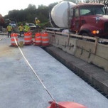 Placing concrete in stemwall and beam seats reconstruction Phase B, Bridge 1017 abutment A
