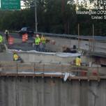 Masons finishing bridge 1017 abutment B beam sets G through J