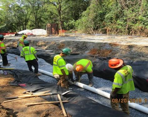 """Installing 6"""" Underdrain Pipe along The Bioswale, NPS Property."""