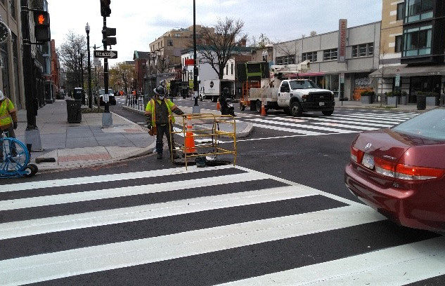 Electricians Splicing Cable At R street