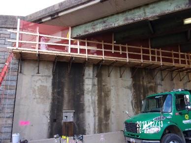Demolishing top portion of Bridge 1016 Abutment A beam seat